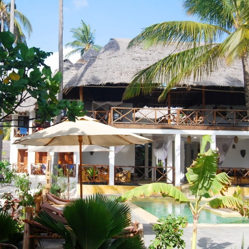 Outdoor swimming pool and private beach at Bwejuu in Zanzibar